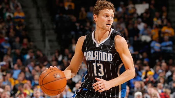 DENVER, CO - JANUARY 07:  Luke Ridnour #13 of the Orlando Magic controls the ball against the Denver Nuggets at Pepsi Center on January 7, 2015 in Denver, Colorado. The Nuggets defeated the Magic 93-90. NOTE TO USER: User expressly acknowledges and agrees that, by downloading and or using this photograph, User is consenting to the terms and conditions of the Getty Images License Agreement.  (Photo by Doug Pensinger/Getty Images)