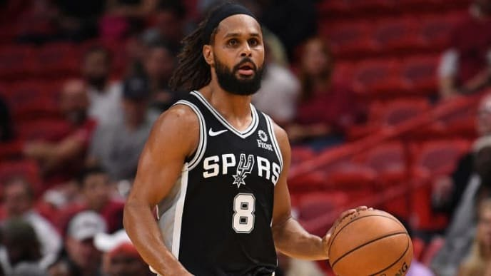 MIAMI, FLORIDA - OCTOBER 08: Patty Mills #8 of the San Antonio Spurs brings the ball up the court against the Miami Heat during the first half of the preseason game at American Airlines Arena on October 08, 2019 in Miami, Florida. NOTE TO USER: User expressly acknowledges and agrees that, by downloading and or using this photograph, User is consenting to the terms and conditions of the Getty Images License Agreement. (Photo by Mark Brown/Getty Images)